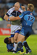 PRETORIA, South Africa, 14 May 2011. Stirling Mortlock (Capt) of the Melbourne Rebels is tackled by Wynand Olivier during the Super15 Rugby match between the Bulls and the Melbourne Rebels at Loftus Versfeld in Pretoria, South Africa on 14 May 2011..Photographer : Anton de Villiers / SPORTZPICS