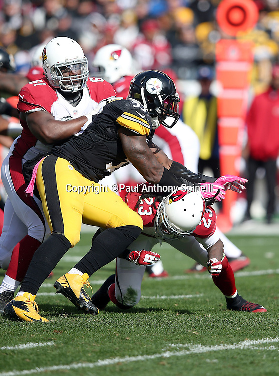 Pittsburgh Steelers outside linebacker Arthur Moats (55) works his way through an illegal chop block by Arizona Cardinals running back Chris Johnson (23) while being blocked by Arizona Cardinals guard Jonathan Cooper (61) during the 2015 NFL week 6 regular season football game against the Arizona Cardinals on Sunday, Oct. 18, 2015 in Pittsburgh. The Steelers won the game 25-13. (©Paul Anthony Spinelli)