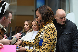 Spice Girls Melanie Brown, Geri Horner and Melanie Chisholm, speak to fans as they leave Global Radio studios in Leicester Square, London.