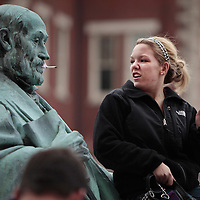 "November 19, 2009 - Lexington, Kentucky, USA - University of Kentucky sophomore ABBEY TAYLOR smoked a cigarette while she sat in the lap of a statue of UK's first president, JAMES PATTERSON, as she and other students have a ""smoke-out"" to protest the University's tobacco ban on campus which began today. About a hundred student smokers and non-smokers gathered to protest the campus-wide tobacco ban UK implemented Thursday by continuously using tobacco products in front of Patterson Office Tower and on the Student Center patio. The ban prohibits the use of cigarettes, pipes, cigars and chewing tobacco, and extends to all properties owned by the university in Fayette County. (Credit image: © David Stephenson/ZUMA Press)"