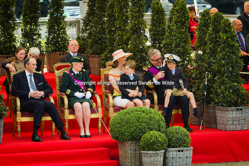 Belgiums National Day  in Brussels July 21, 2012. Belgium celebrates its national day and its 182nd anniversary of independence on this Saturday with a military parade in front of the Royal Palace. From left to right, in the back princess Laetitia Maria, daughter of Prince Lorenz and Princess Astrid (left) and princess Clair and Prince Laurent with their children Nicolas and Aymeric, Nicolas is trying fathers hat.