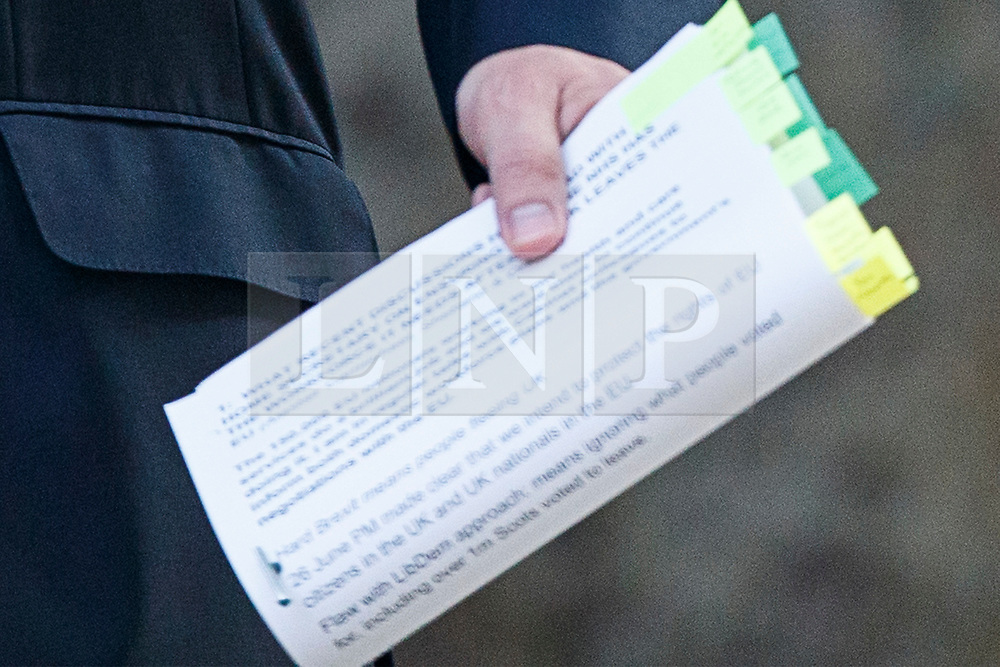 """© Licensed to London News Pictures. 04/07/2017. London, UK. Health Secretary Jeremy Hunt carries a document that reads """"Hard Brexit means people fleeing UK"""" as he attends a cabinet meeting in Downing Street, London on Tuesday, 4 July 2017.Photo credit: Tolga Akmen/LNP"""