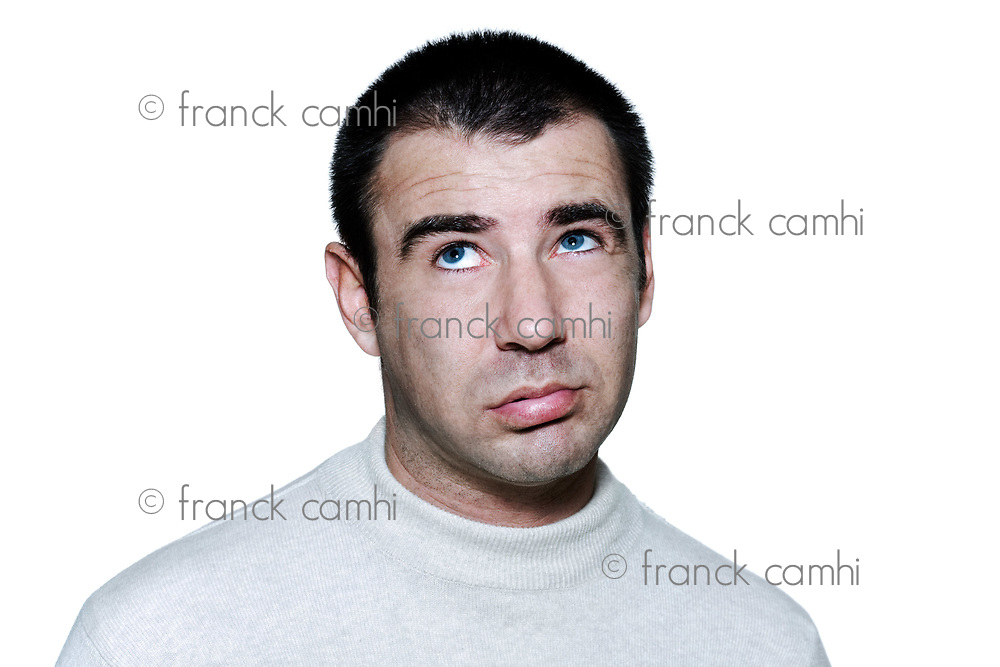 Portrait of an expressive bored man in studio on white isolated background