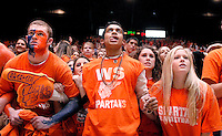 West Springfield High School students intensely watch their team climb back from a large deficit against Lake Braddock in a regional semi-final game. The Spartans ended up losing 75-68.