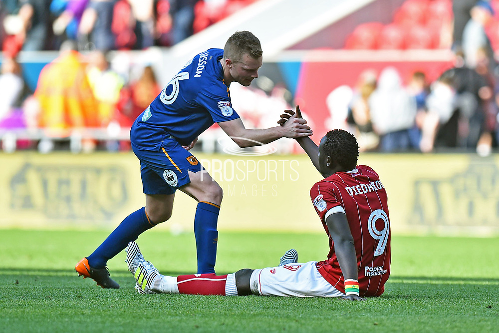 Sebastian Larsson (16) of Hull City helps Famara Diedhiou (9) of Bristol City up at full time after a 5-5 draw during the EFL Sky Bet Championship match between Bristol City and Hull City at Ashton Gate, Bristol, England on 21 April 2018. Picture by Graham Hunt.
