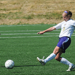 Photos by Tom Kelly IV<br /> WCU's Melissa Rowan (6) pass the ball past IUP's Taylor Vladic (23) during the Indiana University of Pennsylvania (IUP) vs West Chester University (WCU) women's soccer game in East Bradford Township, Wednesday afternoon October 2, 2013.