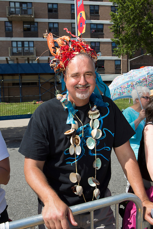 A spectator festooned with lobster and clam shells.