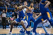 San Jose State Spartans forward Christian Anigwe (11) and  guard Richard Washington (22) box out UCLA Bruins forward Alex Olesinski (0) during an NCAA college basketball game, Sunday, Dec. 1, 2019, in Los Angeles. UCLA defeated San Jose State 93-64. (Jon Endow/Image of Sport)