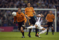 Photo: Rich Eaton.<br /> <br /> West Bromwich Albion v Wolverhampton Wanderers. Coca Cola Championship. Play off Semi Final 2nd Leg. 16/05/2007. Wolves Darren Potter (left)gets to the ball ahead of Diomansy Kamara (right)