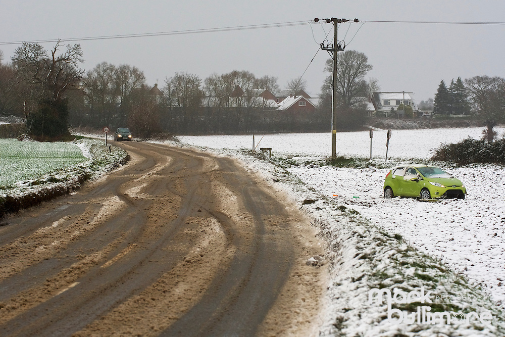 Aylsham, Norfolk. A car abandoned in a field near Aylsham due to the snow falling across Norfolk. <br /> <br /> Picture: MARK BULLIMORE