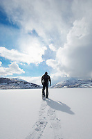 Man Snowshoeing on Pristine Snow
