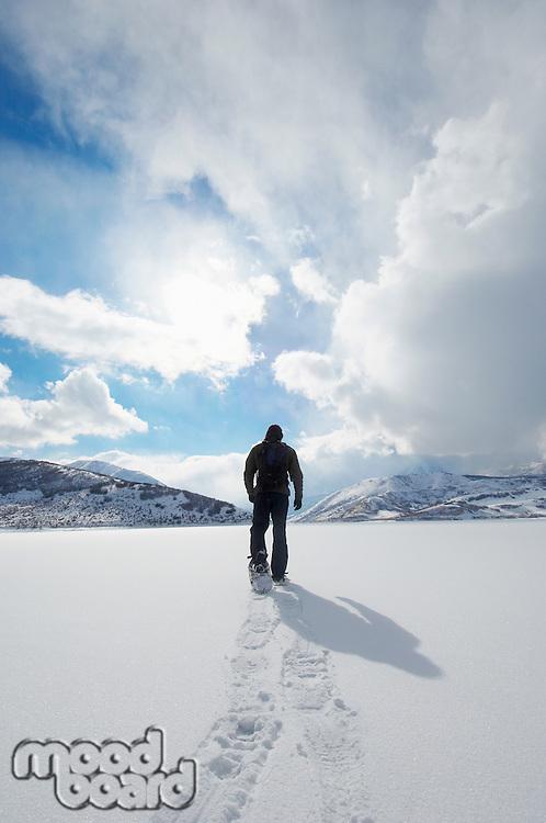 Man Snowshoeing on Pristine Snow