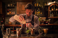Copenhagen, Denmark- JULY 25, 2014: A bartender mixes drinks at Lidkoeb. Located in the Vesterbro neighborhood, Lidkoeb is a cocktail bar hidden away in an alley in a refurbished chemists building. CREDIT: Chris Carmichael for The New York Times