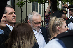 Parliament Square, Westminster, London, June 27th 2016. Thousands of Labour's Momentum members and their supporters gather in Parliament Square in a display of support for embattled Labour Leader Jeremy Corbyn as he suffers numerous calls for his resignation by party members, saying he has does not have the authority to lead the divided party, following his less than emphatic support for Remain in the EU referendum. PICTURED: Surrounded by supporters and members of the press Jeremy Corbyn makes his way from the Commons to address the rally.