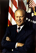 Gerald  Ford (1913-2006) 38th President of the United States 1974-1977. Became President on resignation of Richard Nixon. Head-and-shoulders portrait with stars-and-stripes in background. American Politician Republican