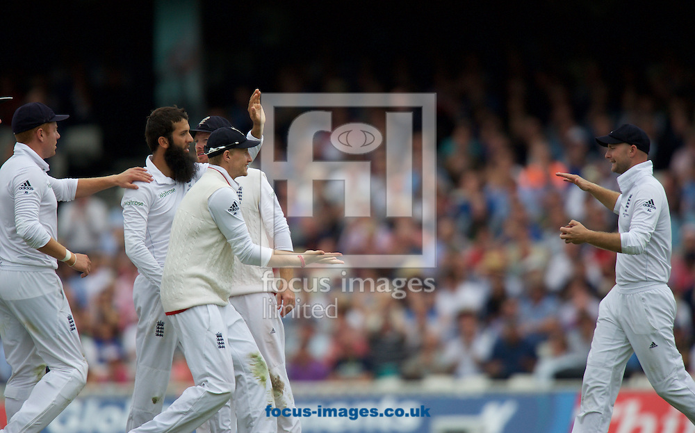 Joe Root of England  waits to congratulate Adam Lyth (right) after taking the wicket of David Warner of Australia with a catch during the 5th Investec Ashes Test Match match at the Kia Oval, London<br /> Picture by Alan Stanford/Focus Images Ltd +44 7915 056117<br /> 20/08/2015