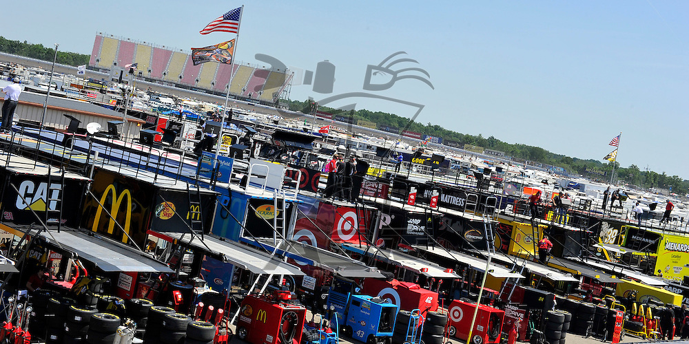 Brooklyn, MI - JUN 15, 2012: A detailed view of Sprint Cup haulers in the garage during practice for the Quicken Loans 400 race at the Michigan International Speedway in Brooklyn, MI.
