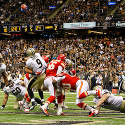 September 23, 2012; New Orleans, LA, USA; New Orleans Saints quarterback Drew Brees (9) is pressured by Kansas City Chiefs defenders in the endzone to throw during the second half of a game at the Mercedes-Benz Superdome. The Chiefs defeated the Saints 27-24 in overtime. Mandatory Credit: Derick E. Hingle-US PRESSWIRE