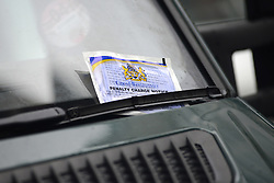 © Licensed to London News Pictures.17/01/2014. London, UK A penalty charge notice is placed on windscreen of lorry on Wardour Street in Soho, London. Wardour Street is the most ticketed road in the country, according to figures obtained under the Freedom of Information Act. Between January and October last year 5,143 tickets were issued, raising up to £410,000..Photo credit : Peter Kollanyi/LNP
