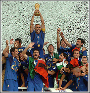 Italian defender Fabio Cannavaro holds up the trophy and celebrates, with his teammates, after winning the World Cup Germany 2006 final football match against France, at Olympic Stadium in Berlin, Germany, on July 9, 2006.  (Alejandro Pagni/PHOTOXPHOTO)