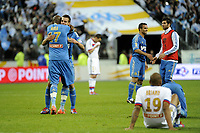 FOOTBALL - FRENCH LEAGUE CUP 2011/2012 - FINAL - OLYMPIQUE LYONNAIS v OLYMPIQUE MARSEILLE - 14/04/2012 - PHOTO JEAN MARIE HERVIO / REGAMEDIA / DPPI - JOY STEPHANE MBIA / CESAR AZPILICUETA (OM) AT THE END OF THE MATCH
