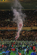 Flare let off by celebrating Middlesborough fans during the Sky Bet Championship Play Off Second Leg match between Middlesbrough and Brentford at the Riverside Stadium, Middlesbrough, England on 15 May 2015. Photo by Simon Davies.