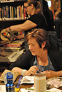 Canada, Ontario Windsor, 2016. Artist Trading Card workshop at Ten Thousand Villages is a MayWorks Windsor 2016 event. Lorraine Steele works on her ttrading card.