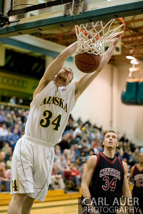 1/6/2006: Junior forward Carl Arts (34) of the UAA Seawolves finishes a thunderous dunk on a fast break as Anchorage goes on to beat the visiting Central Washington Wildcats, 80-60 at the Wells Fargo Sports Complex on the campus of UAA.<br />