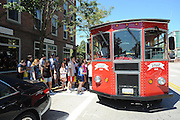 Students board a trolley in downtown Kent after touring the shops and restaurants the city has to offer. The trolley runs during freshman move in day.