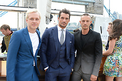 The Johnnie Walker Blue Label and David Gandy Drinks Reception aboard John Walker & Sons Voyager, St.Georges Stairs Tier, Butler's Wharf Pier, London, UK on 16th July 2013.<br /> Picture Shows:-Ben Hudson, David Gandy and Jonathan Saunders.