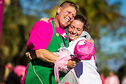 DAVID ALBERS/STAFF<br /> - Breast cancer survivor Sue Dundon, left, embraces her Starbucks coworker Bianca Siggia after running the Susan G. Komen Southwest Florida Race for the Cure at Coconut Point mall on Saturday, March 8, 2014, in Estero.