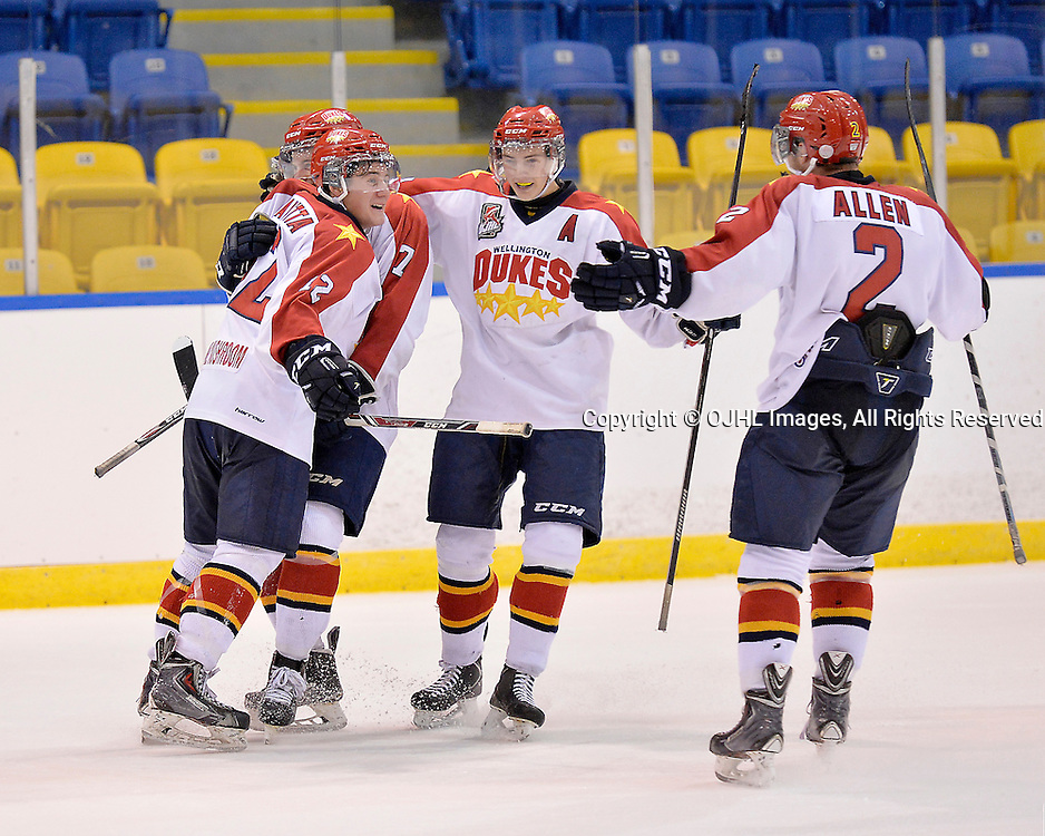 WHITBY, ON - Oct 4, 2015 : Ontario Junior Hockey League game action between Wellington and Whitby, Luc Brown #7 of the Wellington Dukes celebrates the game winning overtime goal with teammates.<br /> (Photo by Shawn Muir / OJHL Images)