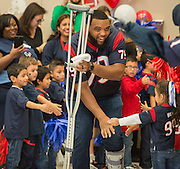 Houston Texans guard Jeff Allen is greeted by students during the Houston launch of the Character Playbook, a joint initiative of the NFL and the United Way Worldwide at Pilgrim Academy, February 3, 2017.