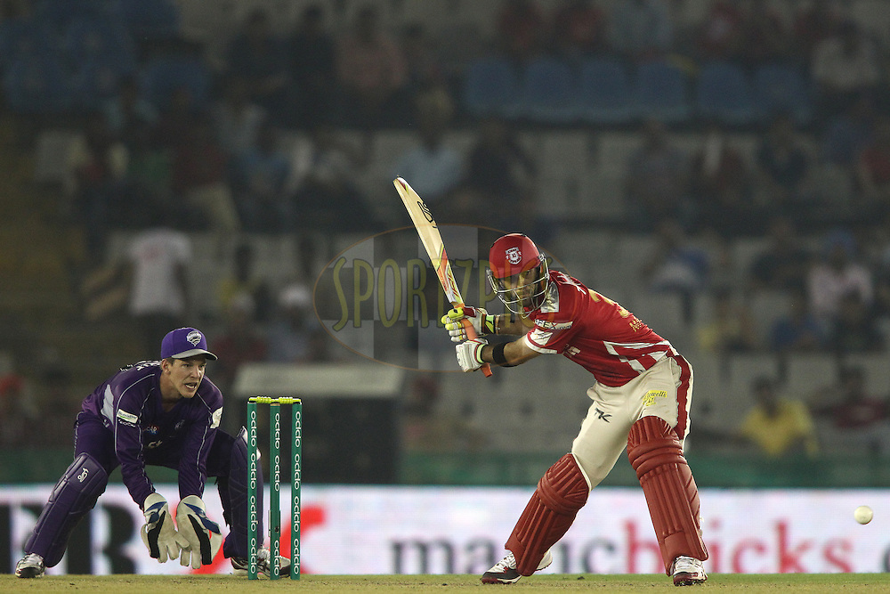 Glenn Maxwell of the Kings XI Punjab looks to attack a delivery during match 2 of the Oppo Champions League Twenty20 between the Kings XI Punjab and the Hobart Hurricanes held at the Punjab Cricket Association Stadium, Mohali, India on the 18th September 2014<br /> <br /> Photo by:  Shaun Roy / Sportzpics/ CLT20<br /> <br /> <br /> Image use is subject to the terms and conditions as laid out by the BCCI/ CLT20.  The terms and conditions can be downloaded here:<br /> <br /> http://sportzpics.photoshelter.com/gallery/CLT20-Image-Terms-and-Conditions-2014/G0000IfNJn535VPU/C0000QhhKadWcjYs