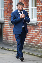 Jason Stroud, 41, of West Drayton, West London, lights a cigarette outside Uxbridge Magistrate's Court where he pleaded guilty to threatening a bus driver with a chainsaw. Uxbridge, April 11 2018.