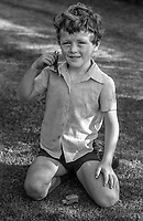Mark Maguire, 7 years, who survived the tragic incident in which his sister, Joanne, 8 years, and brothers,  Andrew, 6 months, and John, 2 years, died on 10th August 1976 in Belfast, N Ireland. The deceased members of his family were hit by an out-of-control car driven by Provisional IRA activist, Danny Lennon. Lennon had been shot by British soldiers pursuing his vehicle. The deaths of the three Maguire children triggered the formation of the Peace People organization.  197608110354MM1<br /> <br /> Copyright Image from Victor Patterson, 54 Dorchester Park, Belfast, UK, BT9 6RJ<br /> <br /> t1: +44 28 9066 1296 (from Rep of Ireland 048 9066 1296)<br /> t2: +44 28 9002 2446 (from Rep of Ireland 048 9002 2446)<br /> m: +44 7802 353836<br /> <br /> victorpattersonbelfast@gmail.com<br /> victorpatterson@me.com<br /> <br /> www.victorpatterson.com<br /> <br /> Please see my Terms and Conditions of Use at https://www.victorpatterson.com/page2<br /> It is IMPORTANT that you familiarise yourself with them.<br /> <br /> Images used on the Internet incur an additional cost and must be visibly watermarked i.e. © Victor Patterson within the body of the image and copyright metadata must not be deleted. Images used on the Internet have a size restriction of 4kbs and are chargeable at rates available at victorpatterson.com.<br /> <br /> This image is available only for the use of the download recipient i.e. television station, newspaper, magazine, book publisher, etc, and must not be passed on to any third party. It is also downloaded on condition that each and every usage is notified within 7 days to victorpatterson@me.com<br /> <br /> The right of Victor Patterson (or the named photographer) to be identified as the author is asserted in accordance with The Copyright Designs And Patents Act (1988). All moral rights are asserted.