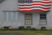 Old barn with American flag near Oysterville, Washington on the Long Beach Penisula