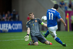 (R) Italy's Antonio Di Natale (nr11) shoots goal for Italy above (L) Spain's goalkeeper Iker Casillas (nr01) during their the UEFA EURO 2012 Group C football match between Spain and Italy at Gdansk Arena in Gdansk on June 10, 2012...Poland, Gdansk, June 10, 2012..Picture also available in RAW (NEF) or TIFF format on special request...For editorial use only. Any commercial or promotional use requires permission...Photo by © Adam Nurkiewicz / Mediasport