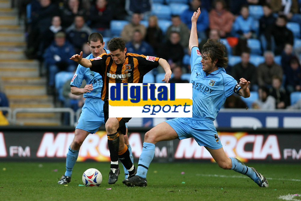 Photo: Pete Lorence.<br />Coventry City v Hull City. Coca Cola Championship. 03/03/2007.<br />Elliott Ward slides in on Nicky Forster.