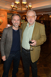 Left to right, chefs MARCUS WAREING and  PIERRE KOFFMANN at a party to celebrate the publication of 'Let's Eat meat' by Tom Parker Bowles held at Fortnum & Mason, Piccadilly, London on 21st October 2014.