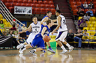 November 27th, 2010:  Anchorage, Alaska - Drake Bulldog Ryan Wedel (10) drives the ball against the Weber State defense in the 81-82 Drake loss to Weber State in the third place game at the Great Alaska Shootout.