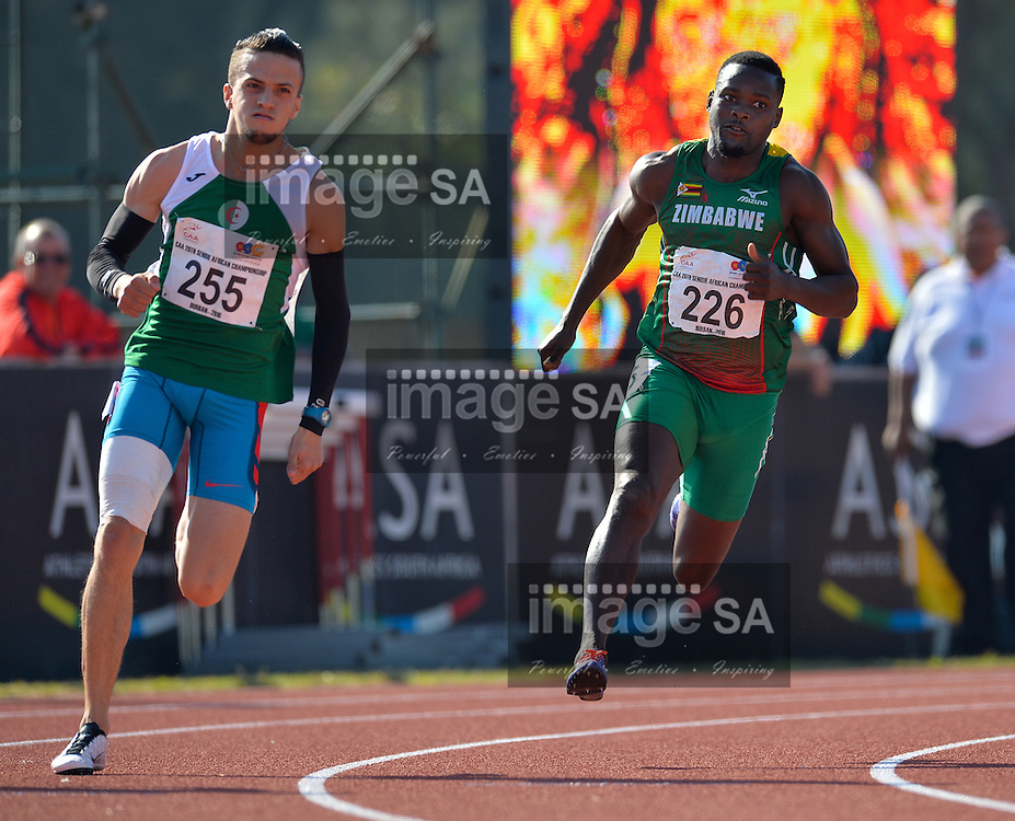 DURBAN, SOUTH AFRICA - JUNE 25: Skander Djamil Athmani of Algeria and Gabriel Mvumvure of Zimbabwe in the heats of the mens 200m during the morning session on day 4 of the CAA 20th African Senior Championships at Kings Park Athletic stadium on June 25, 2016 in Durban, South Africa. (Photo by Roger Sedres/Gallo Images)