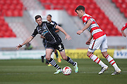 Colchester United forward Chris Porter (9) tries to block the cross  during the EFL Sky Bet League 2 match between Doncaster Rovers and Colchester United at the Keepmoat Stadium, Doncaster, England on 15 October 2016. Photo by Simon Davies.