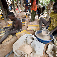 Local mining for gold in the village of Mongbwalu in Eastern Congo. Rocks that contain Gold are pounded into powder to separate the Gold from the rock.