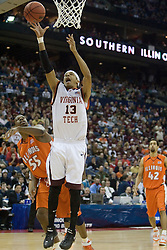 Virginia Tech Hokies forward Deron Washington (13) shoots over Illinois Fighting Illini forward/center Shaun Pruitt (55).  The #5 seed Virginia Tech Hokies defeated the #12 seed Illinois Illini 54-52 in the first round of the Men's NCAA Tournament in Columbus, OH on March 16, 2007.