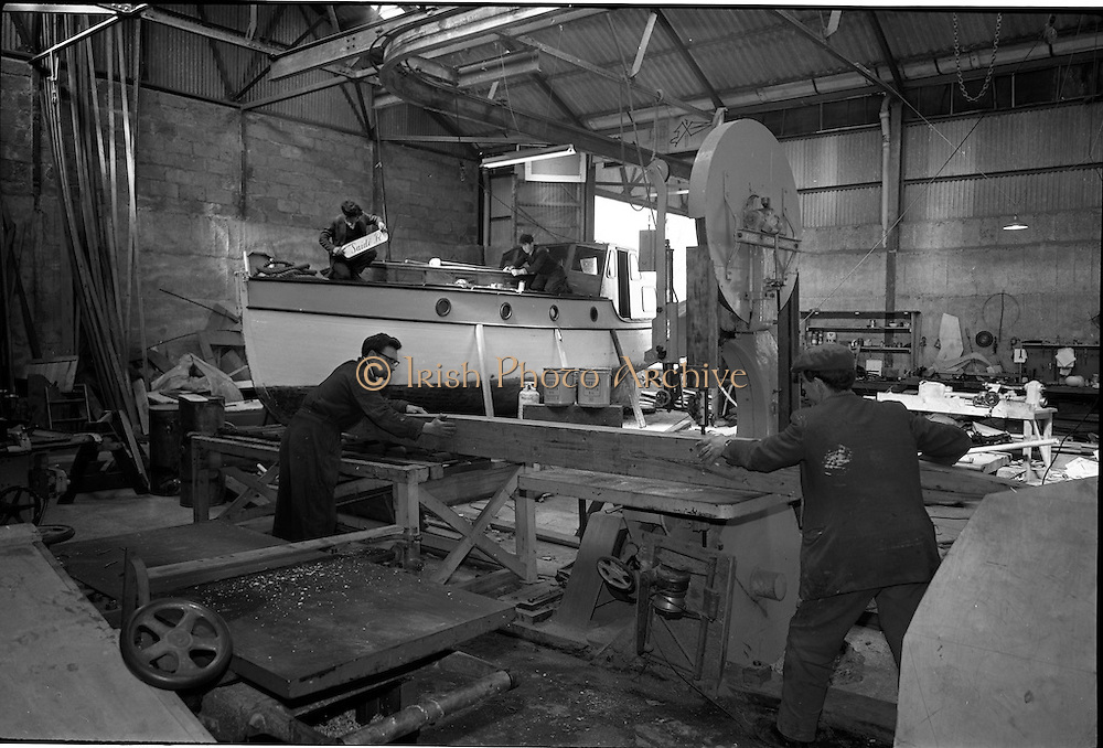 06-10/04/1964.04/06-10/1964.06-10 April 1964.Views on the River Shannon. Boatbuilders repairing a craft at the sheds of Mr George O'Brien Kennedy's K. Line Boats, Shannon Harbour, Co. Offaly.