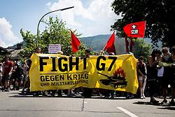 05.06.2015, Garmisch Partenkirchen, GER, G7 Gipfeltreffen auf Schloss Elmau, Circa 300 Menschen demonstrieren in Garmisch-Patenkirchen gegen den G7-Gipfel im benachbarten Elmau, im Bild Demoteilnehmer halten ein Transparent // during Protest of the G7 opponents prior to the scheduled G7 summit which will be held from 7th to 8th June 2015 in Schloss Elmau near Garmisch Partenkirchen. Garmisch Partenkirchen, Germany on 2015/06/05. EXPA Pictures © 2015, PhotoCredit: EXPA/ Eibner-Pressefoto/ Gehrling<br /> <br /> *****ATTENTION - OUT of GER*****