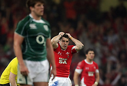 Stephen Jones watches in agony as his last minute penalty that would have secured victory for Wales slips past and hands the Grand Slam to Ireland.RBS 6 Nations 2009, Wales v Ireland.Millennium Stadium, 21.03.09