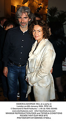 DAMON & GEORGIE HILL at a party in London on 8th January 2004.PPS 148