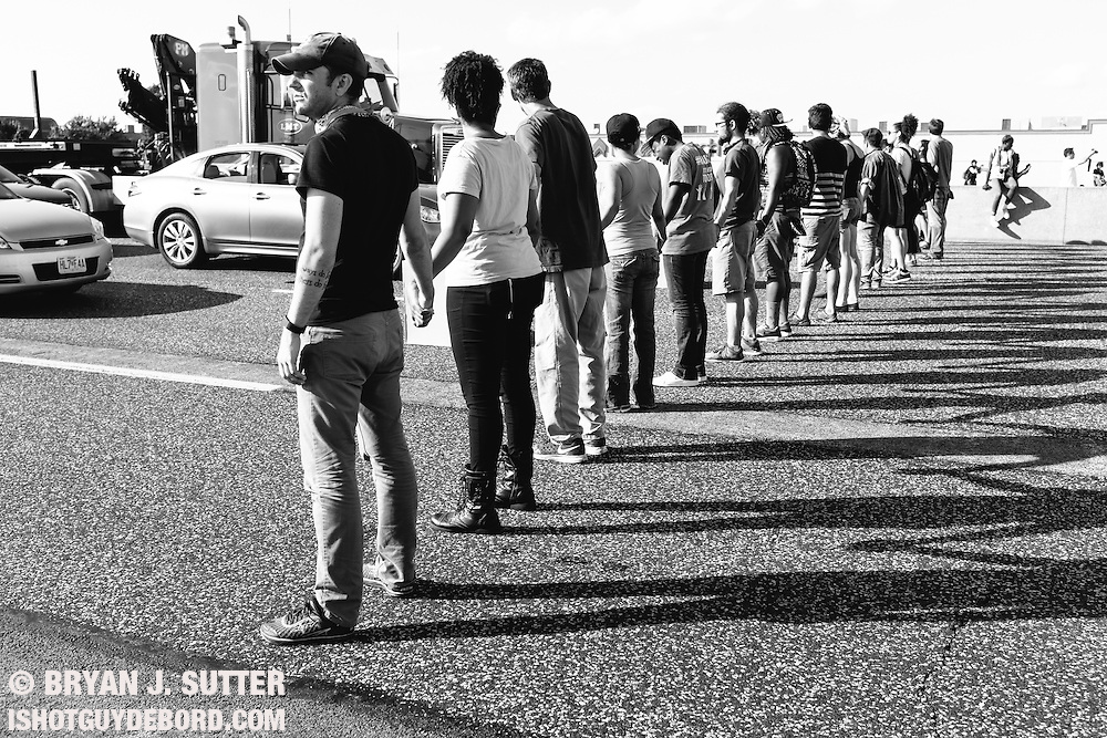 A line of protesters block eastbound traffic on highway 70 near the Missouri River on August 10th, 2015.